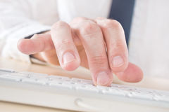 Businessman typing on his computer Stock Image