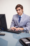 Businessman typing on his keyboard Royalty Free Stock Photography