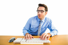 Businessman typing on his keyboard wearing glasses. On white background Stock Image