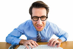 Businessman typing on his keyboard wearing glasses. On white background Stock Photography