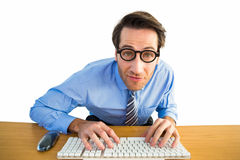 Businessman typing on his keyboard wearing glasses. On white background Royalty Free Stock Images
