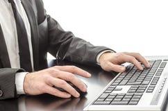 Businessman typing on keyboard Stock Photos