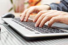 Businessman  is typing on keyboard Royalty Free Stock Image