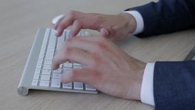 Closeup of businessman arms typing on keyboard. Businessman typing on keyboard closeup stock video