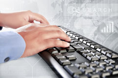 Businessman is typing on keyboard Royalty Free Stock Photos