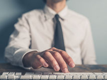 Businessman typing on a keyboard Stock Photos