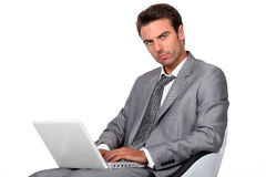 Businessman typing on laptop Royalty Free Stock Images