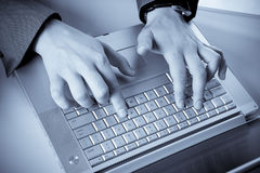 Businessman typing on a laptop Royalty Free Stock Image