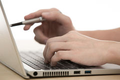 Businessman typing on laptop computer Royalty Free Stock Images