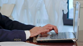 Businessman is typing on laptop computer. Closeup of businessman typing on laptop computer. Professional shot in 4K resolution. 055. You can use it e.g. in your stock video