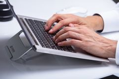 Businessman Typing On Laptop Keypad. Close-up Of A Businessman`s Hand Typing On Laptop Keypad royalty free stock photography