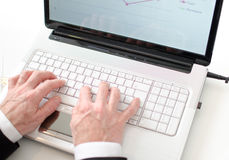 Businessman typing on a laptop Royalty Free Stock Photo