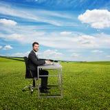 Businessman typing at laptop Royalty Free Stock Photos