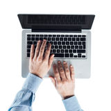 Businessman typing on a laptop Stock Images