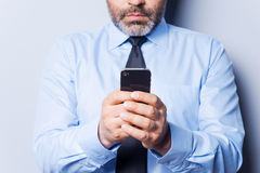 Businessman typing messages. Stock Photo