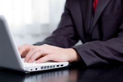 Businessman typing on a notebook Royalty Free Stock Photo