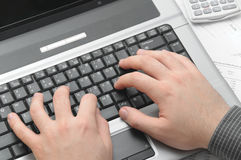 Businessman typing on notebook (laptop) Royalty Free Stock Photo