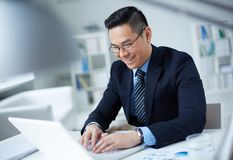 Businessman typing Royalty Free Stock Photos