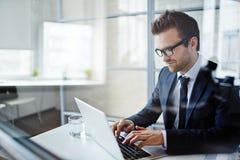 Businessman typing Royalty Free Stock Image