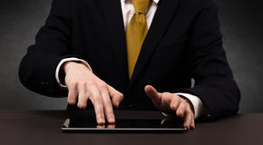 Businessman typing tablet touchscreen Royalty Free Stock Image