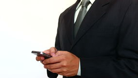 Businessman Typing a Text Message. A young Businessman On a Mobile Phone Typing a Text Message stock footage