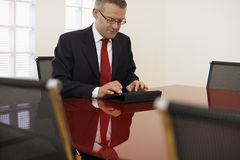 Businessman typing on touch pad computer Stock Image