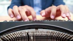 Businessman typing on typewriter stock video footage