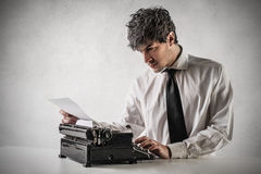 Businessman typing on the typewriter Royalty Free Stock Photography