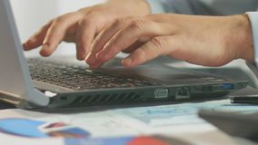 Businessman typing weekly report on laptop computer, close-up of male hands. Stock footage stock footage