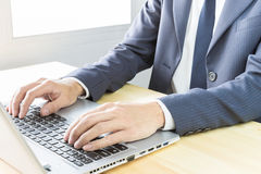 Businessman Typing or Working with Laptop or Notebook Stock Photos