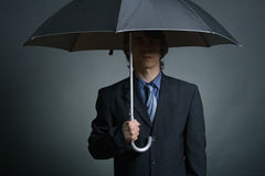 Businessman with Umbrella Royalty Free Stock Photos