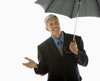 Businessman with umbrella. Royalty Free Stock Image