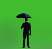 Businessman with umbrella. Black background with copyspace. Busi Royalty Free Stock Photo