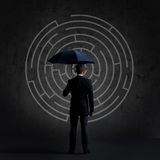 Businessman with umbrella. Black background with copyspace. Busi Royalty Free Stock Image