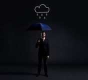 Businessman with umbrella. Black background with copyspace. Busi Royalty Free Stock Images
