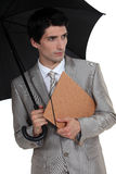 Businessman with an umbrella Royalty Free Stock Images