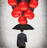 Businessman with umbrella Stock Photos