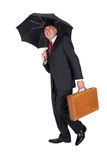 Businessman with umbrella holding a briefcase Royalty Free Stock Photo