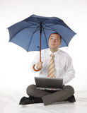 Businessman with umbrella and laptop Stock Image