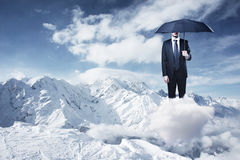 Businessman with umbrella Stock Photos