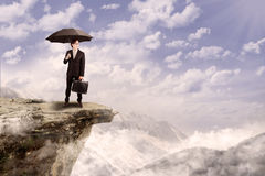 Businessman with umbrella outdoor Royalty Free Stock Image