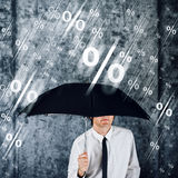 Businessman with umbrella protecting himself from percentage rai Royalty Free Stock Image