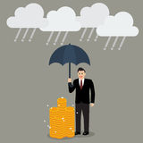 Businessman with umbrella protecting his money from financial cr. Isis. money risk management concept Stock Photos
