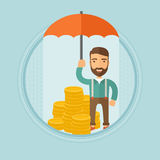Businessman with umbrella protecting money. Stock Images