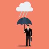Businessman with umbrella in rain Royalty Free Stock Image