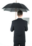 Businessman with an umbrella Stock Photos