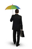 Businessman with umbrella Stock Images