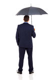 Businessman umbrella Stock Photos