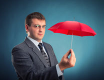 Businessman with an umbrella Royalty Free Stock Image
