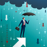 Businessman with an umbrella on arrow Stock Images